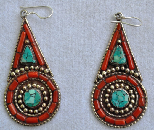 Circle and Triangle design, beautiful look each piece handcrafted with coral, turquoise and small metal balls size hands to 2 inch and 1 inch diameter and fashionable wearing from east.