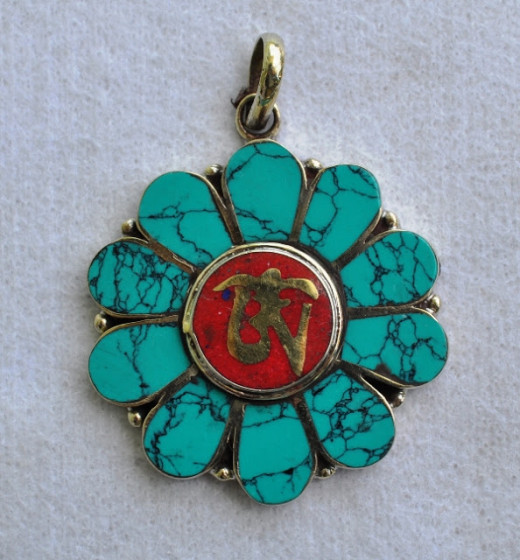 Om and flower Design pendant 1.75 inch diameter made of German silver with turquoise stone