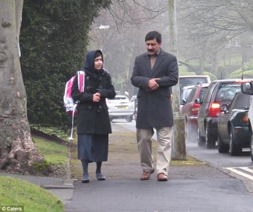 Fresh start: Malala walked to Edgbaston High School in Birmingham accompanied by her father, Ziauddin