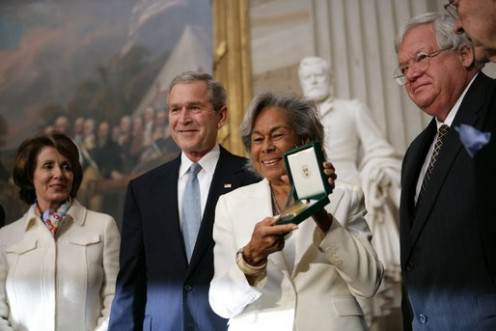 Mrs. Rachel Robinson accepts the Congressional Gold Medal for husband Jackie Robinson (1919 - 1972). (From left to right: Congresswoman Nancy Pelosi, former President George W. Bush, Rachel Robinson, Congressman Dennis Hastert.)