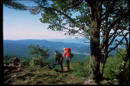 Some backpackers enjoying a view along the AT in the Shenandoah National Park.
