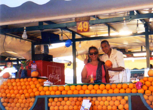 Sure he's smiling -- he got $2 for 35-cents' worth of juice! (I'm smiling because it was worth it.) Medina in Marrakech, Morocco.