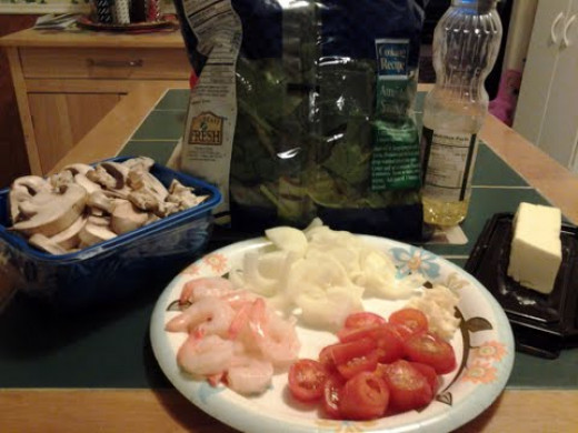 The ingredients for shrimp and spinach saute