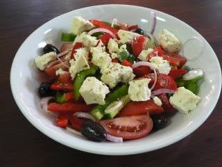 A plate with Greek salad.