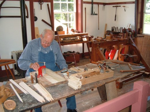 Artisan making boxes in traditional Shaker manner