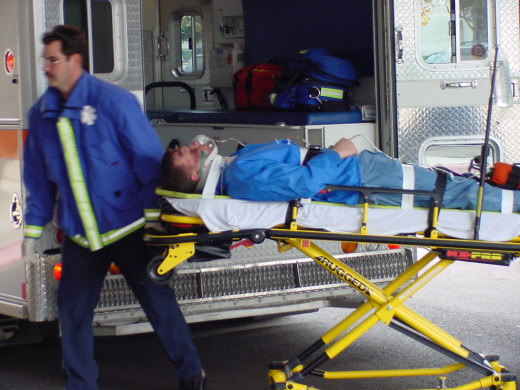 Paramedic transporting a patient.