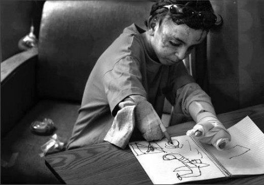 An Iraqi boy draws the war planes that bombed his house, killing all his family members, and injuring him.