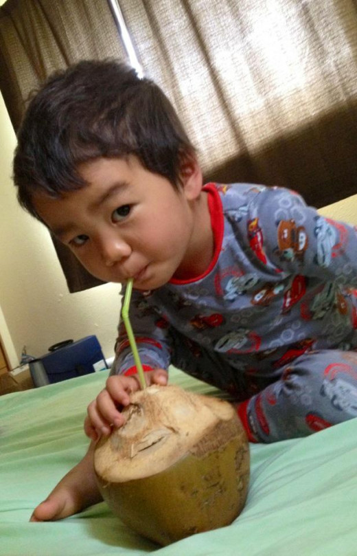 "2-Year-Old Kalaunuiohua Enjoying Coconut Water--""It's what you need, Uncle Joe, to write the next 100 hubs!"""