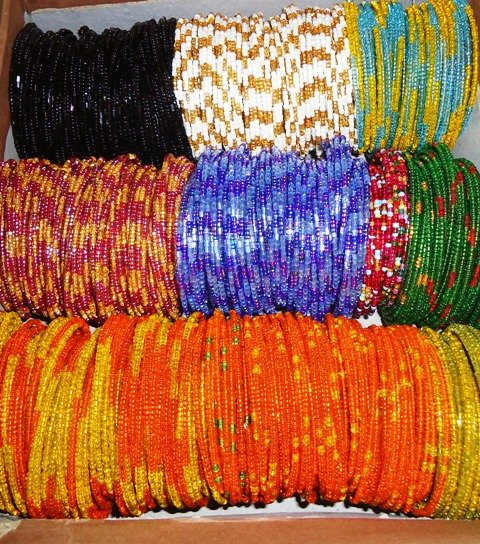 Glass bead traditional bangles. These bangles makes clinking sound which adds charm.