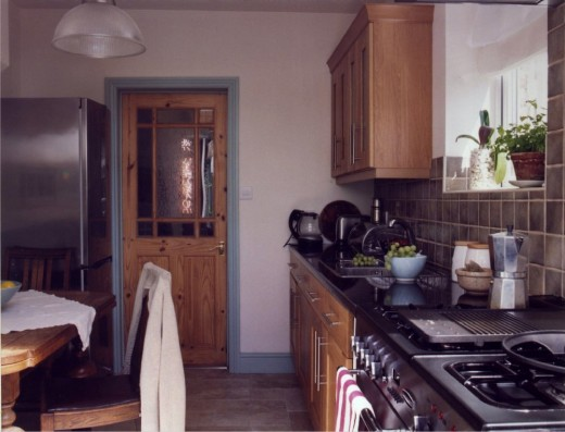 Duck-egg blue panelling and woodwork follows through to kitchen.