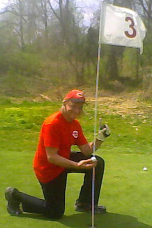"""Mike """"Ace"""" Kruse revels in his Hole-in-One at the Sugar Bay Golf Course in Warsaw, Kentucky."""
