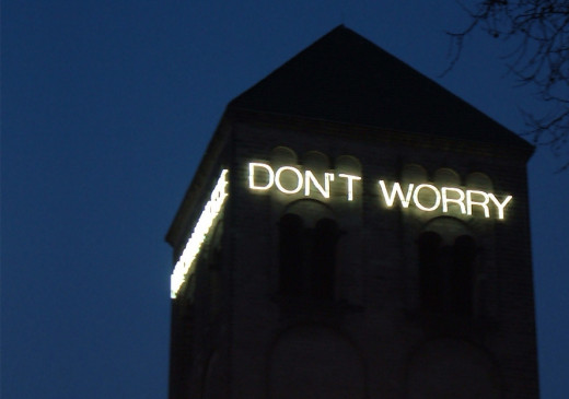 """Don't Worry"" shines from the romance tower of Saint Peter Cologne with durable light installation."