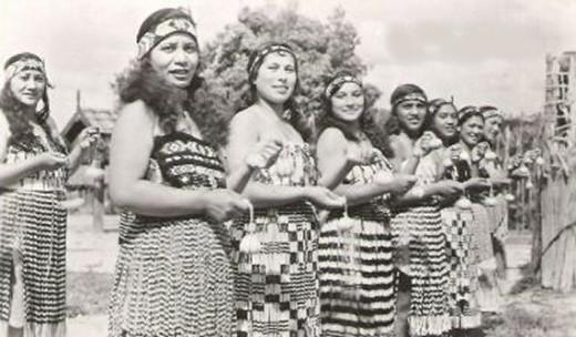 Young Maori women performing a Poi dance