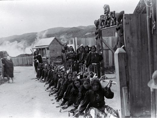 A line of Maori women perform a Poi dance