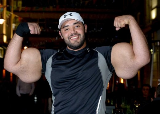 "Moustafa Ismail and his biceps, by some accounts the world's largest arms.  He is sometimes called the ""human Popeye."""