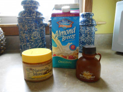 Natural peanut butter, almond milk and pure maple syrup are foods that can be enjoyed on a vegan diet.