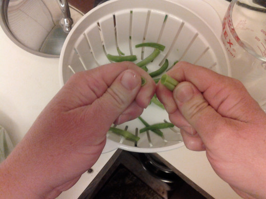 You can just pinch off the ends of the green beans with your hands, instead of using a knife ot kitchen scissors.