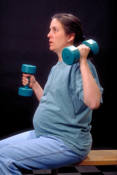 Pregnant Woman with Dumbbells
