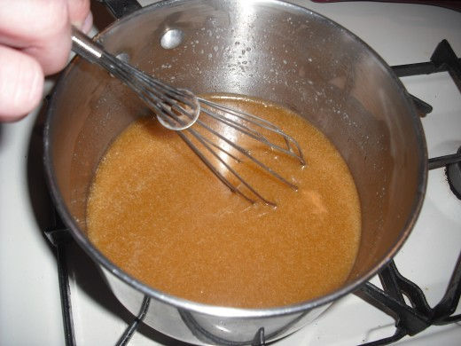 Stir the brown sugar into the melted butter, and whisk until the mixture bubbles and the sugar is thoroughly melted into the butter.