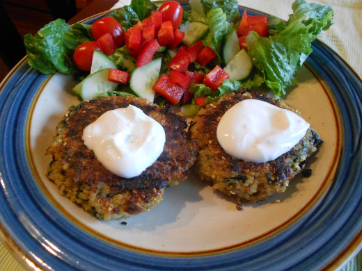 Quinoa patties served with lemon yogurt sauce and salad.