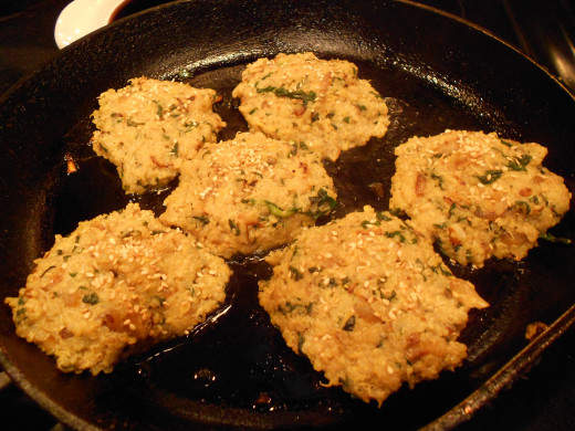 Cook Quinoa patties in remaining olive oil in a skillet.  Turn two to three times.  Cook for about 8-10 mins in total.