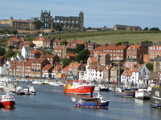 A fine view of Whitby. The abbey and church are on the hill above the houses.