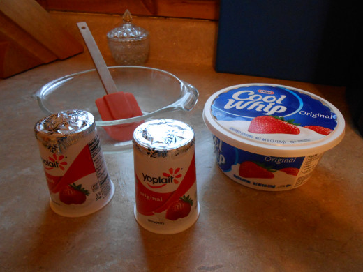 Use a clear Pyrex mixing bowl and rubber spatula to mix the Cool Whip and yogurt.