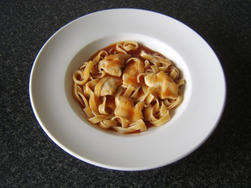 Fried chicken strips and tagliatelle pasta are stirred through sweet and sour sauce