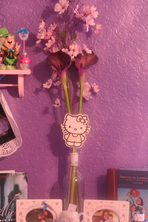 I reused this wine bottle as a vase for my baby girl's room.