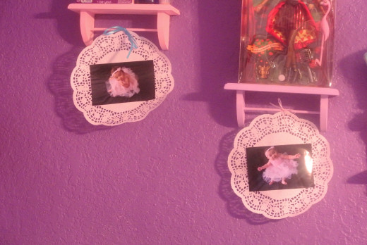 I had several leftover paper doilies that were taking up space so I used some of them as picture holders for décor in my little girl's room.  They went with the tea party/Alice in Wonderland theme she had.
