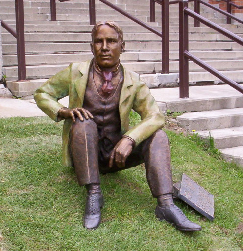 Bronze sculpture of William Lyon Mackenzie King as a young man, by Ruth Abernethy. Located on the front lawn of Kitchener-Waterloo Collegiate and Vocational School.