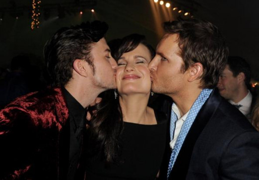 I wish I could be that woman in the sandwich of hot men.