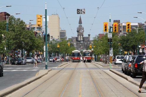 Northbound and southbound streetcars meet on the Spadina line, south of College.