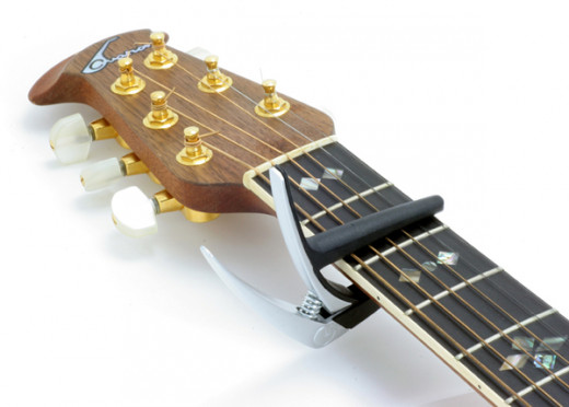 A capo on a guitar