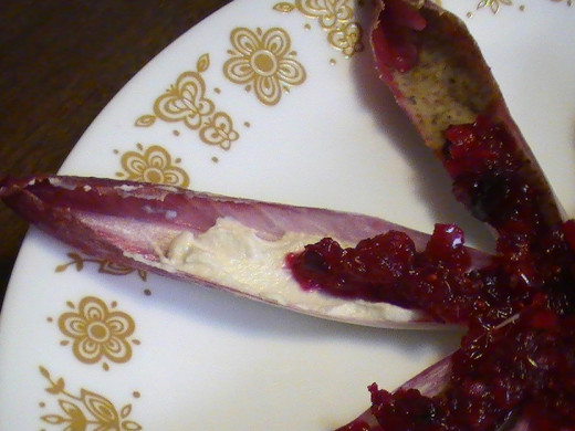 Endive, cashew cream, and raw almond butter, ganished with raw cranberry sauce.
