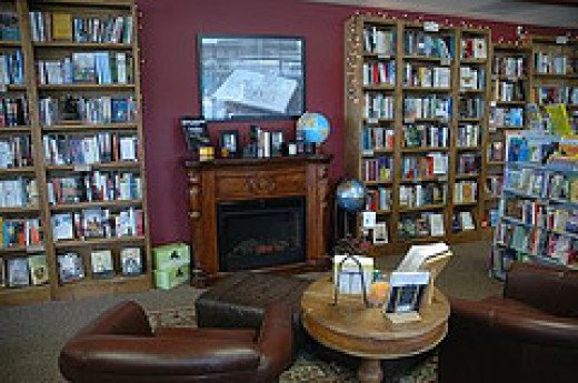 A fireplace and cozy chairs- perfect for a book store.