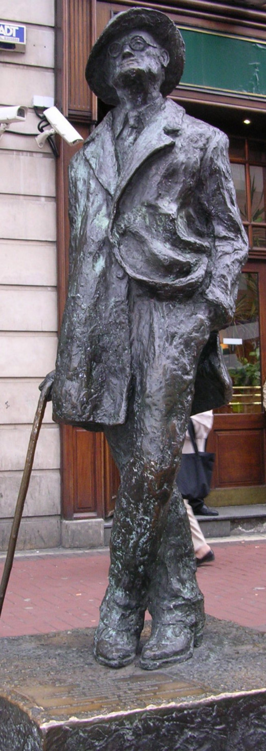 James Joyce statue on North Earl Street near its junction with O'Connell Street in Dublin, by Marjorie FitzGibbon. Photo by Toniher. CC-BY-SA 2.5.