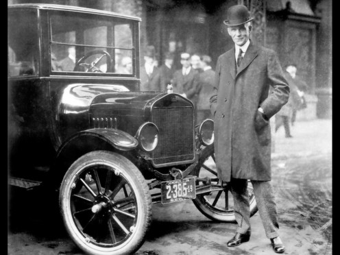 Henry Ford with his iconic Model T  Ford.