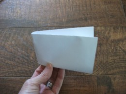 Fold a center crease to use as a guide as you draw.