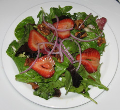 Relieve premenstrual symptoms with a delightful strawberry and walnut salad.