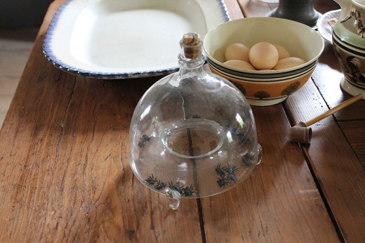 Another style of glass fly trap used on a dining room table