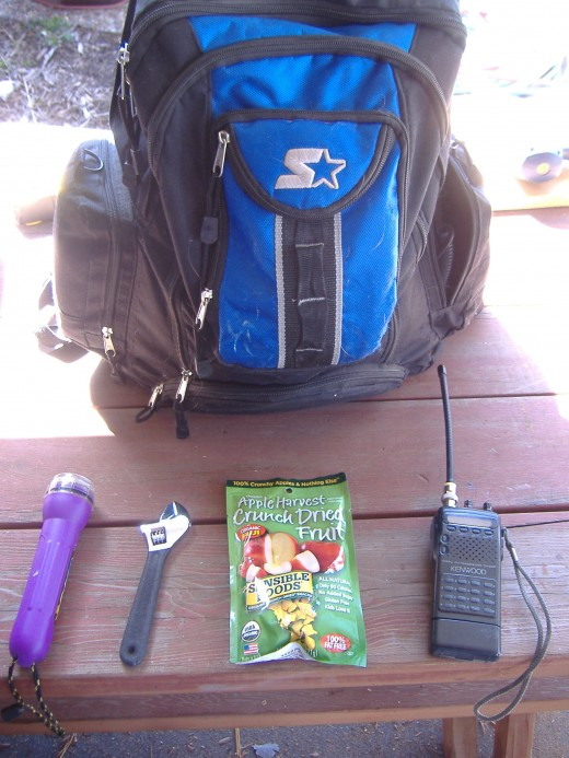 Here are a few of the things to keep in a supply kit: Flashlights (with batteries), Tools, food, and a two way radio (if available).  Put these items in the bag and you're ready to go.