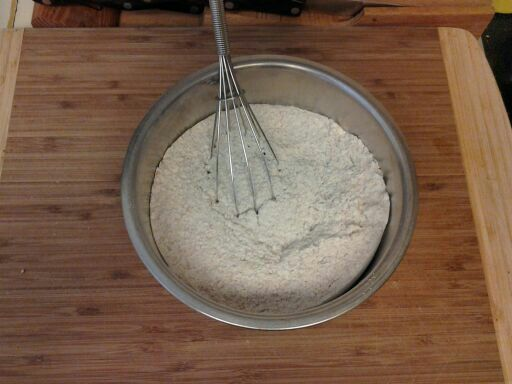 sifting the baking soda, salt and flours together