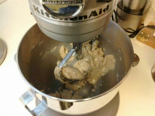 Beating together the brown sugar, white sugar, and butter.