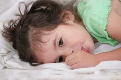 The top of a mattress for a toddler should not be too soft. More cushion can always be added later with a Topper as the child grows. Photo Credit: David Castillo Dominici on freedigitalphotos.net