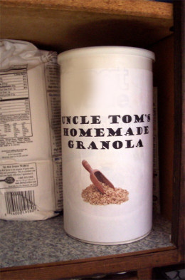 An empty oatmeal box with a homemade label makes a great storage container.