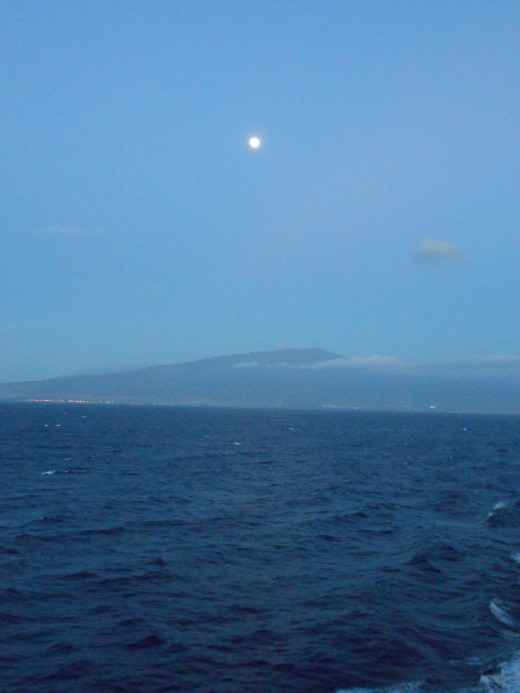 The peace of the moon over the sea at dusk.