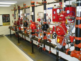 Wet sprinkler systems in all up to fire code buildings hold water in the lines and in reserve in the event of a fire. This are linked to a fire pump that automatically kicks in when a pressure drop is detected.