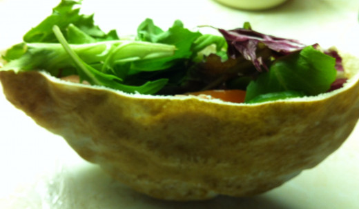 Whole wheat pita stuffed with avocado, tomato, lettuce and onions
