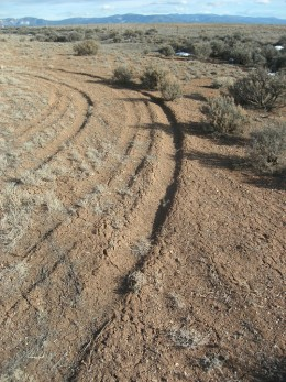 Tire tracks near the rim of the Rio Grande Gorge